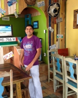 Polo, proud owner of Mango Cafe, voted 'Best Place to Eat Breakfast' on Isla Mujeres